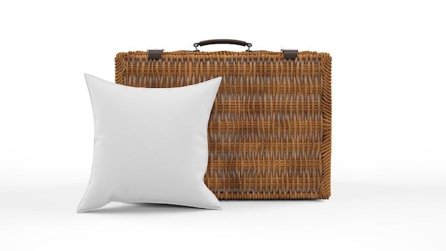 Poduszka w szarym kolorze i wiklinowa walizka na białym tle