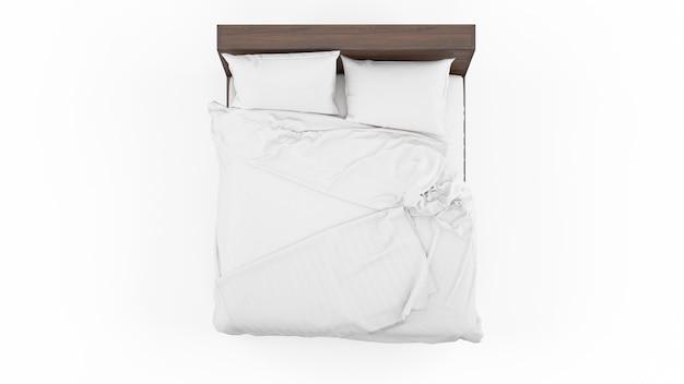 Podwójne łóżko z białą narzutą i kołdrą na białym tle, widok z góry