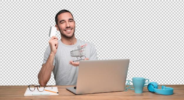 Pojęcie szczęśliwy młody człowiek który kupuje na internecie