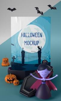 Postać wampira obok makiety halloweenowej karty