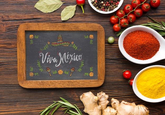 Pozioma tablica z ramą otoczona przyprawami i ziołami