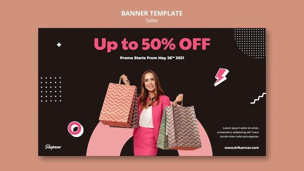 Poziomy baner sprzedaży z kobietą w różowym garniturze
