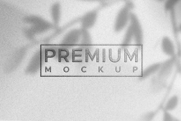 Prosty makieta logo na fakturze białego papieru - kolor srebrny