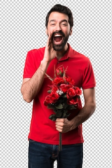 Przystojny mężczyzna trzyma kwiaty krzyczeć