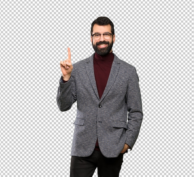 Przystojny mężczyzna w okularach pokazując i podnosząc palec na znak najlepszych