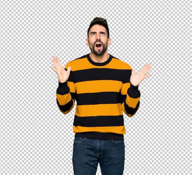 Przystojny mężczyzna w paski sweter sfrustrowany złej sytuacji