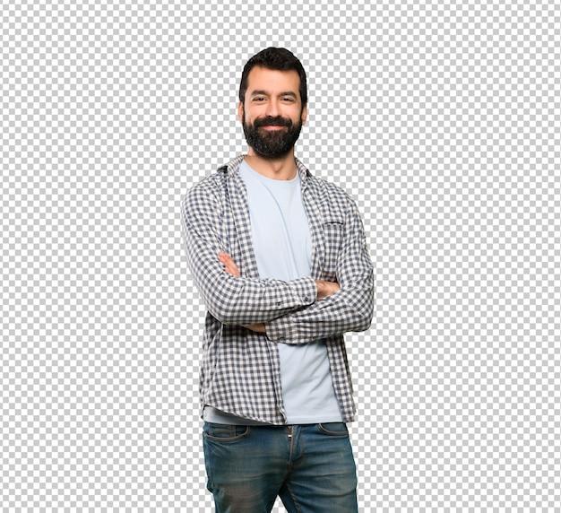 Przystojny mężczyzna z brodą, trzymając ręce skrzyżowane w pozycji czołowej