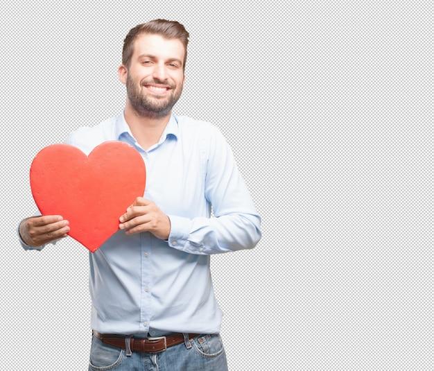 Przystojny młodego człowieka mienia serce