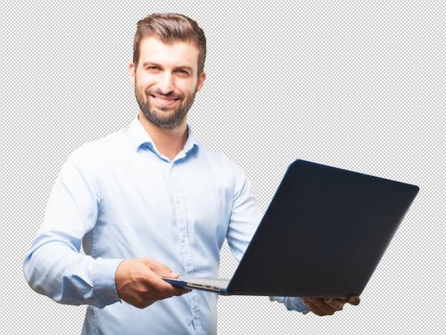 Przystojny młody człowiek z laptopem