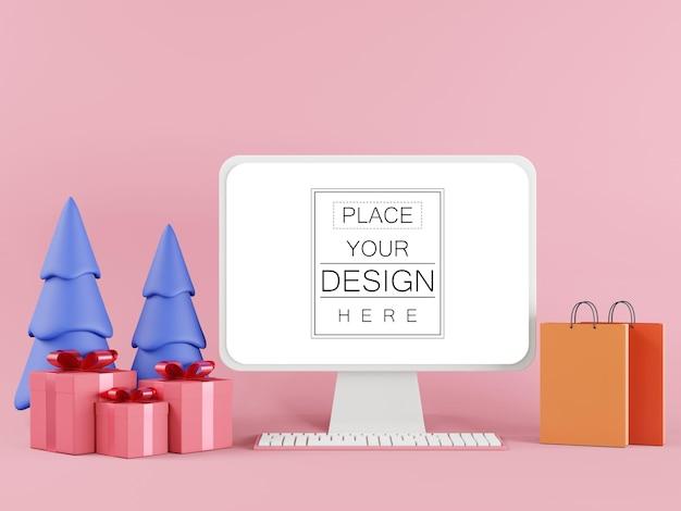 Pusty ekran monitor komputera z torby na zakupy i pudełka na prezenty