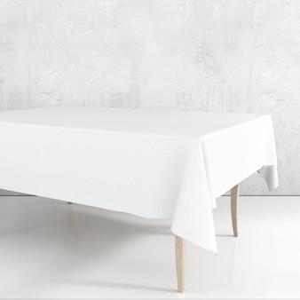 Pusty makieta stół jadalny z białym obrusem
