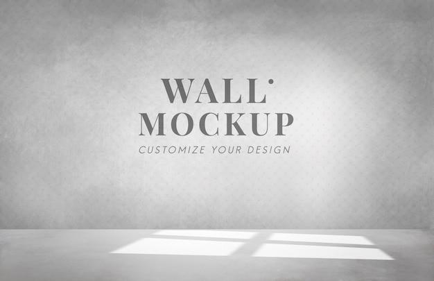 Pusty pokój z makietą szarej ściany