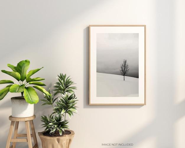 Ramka na zdjęcia z makietą roślin na ścianie