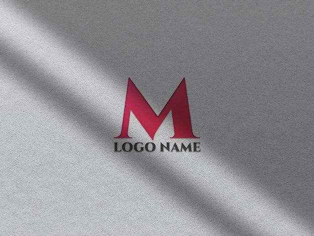 Realistyczna makieta wytłoczonego logo z nakładką cienia