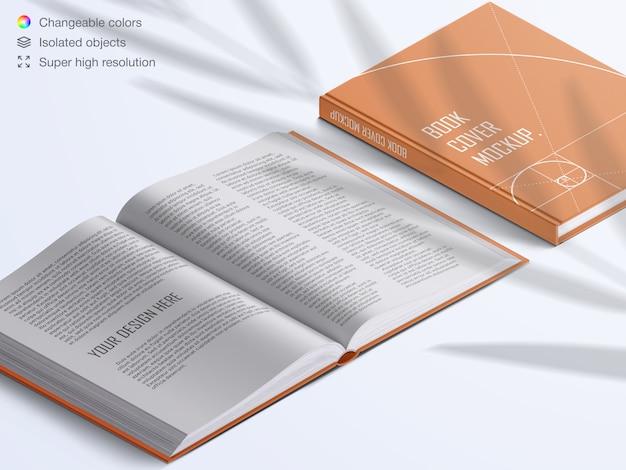 Realistyczna okładka książki z dużym kątem i otwarte strony książki z makietą nakładki cienia