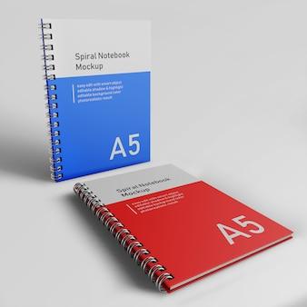 Realistyczne dwa office hard cover spiral binder notatnik mock up szablon projektu stojąc i odpoczynku z przodu widok perspektywy