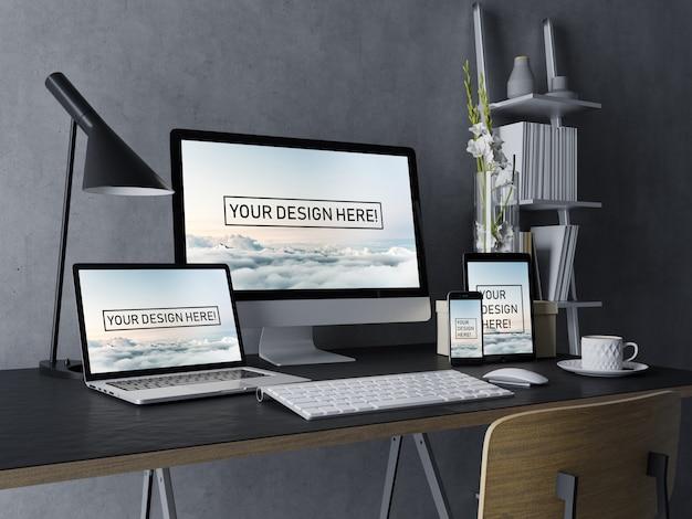 Realistyczny zestaw pulpitu, laptopa, tabletu i smartfona makiety szablonu projektu z edytowalnym ekranem w czarnym nowoczesnym wnętrzu przestrzeni roboczej