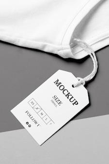 Rozmiar ubrań biały makieta wysoki widok i biały ręcznik
