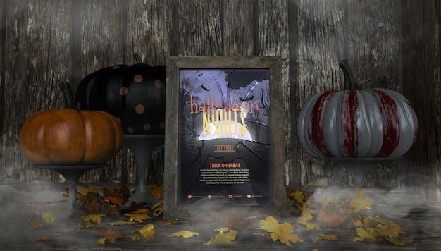 Różnorodne kolorowe dynie i halloweenowe makiety tworzą ramkę