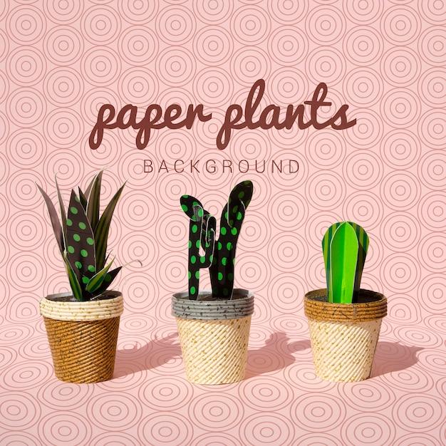 Różnorodne papierowe rośliny w garnka tle