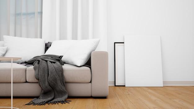 Salon z szarą sofą i pustym płótnem lub ramką na zdjęcia
