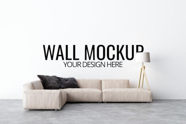Ścienna makieta w białym wnętrzu z sofą i dekoracją