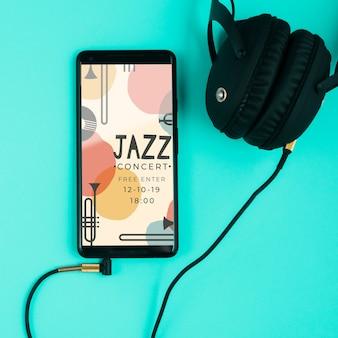 Słuchawki podłączone do telefonu komórkowego