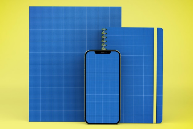 Smartfon, notatnik i makieta strony
