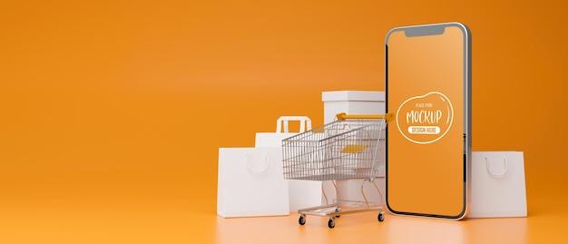 Smartfon z ekranem makiety komponującym się na żółtym tle z wózkiem i torbami na zakupy