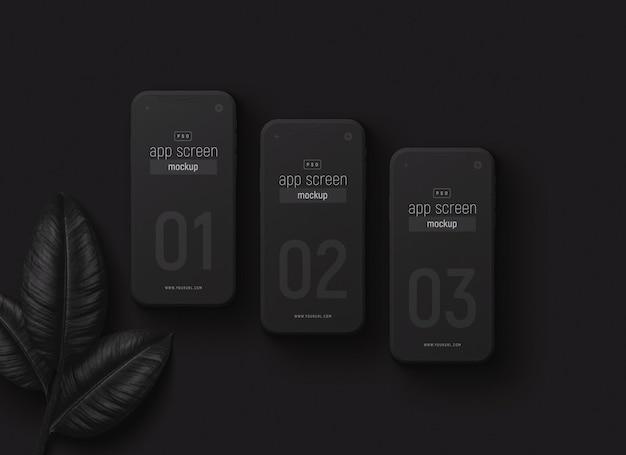 Smartfony ustawiają makietę z czarnymi liśćmi