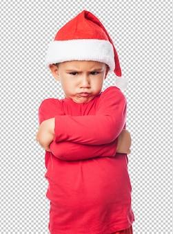 Smutne małe dziecko chłopiec obchodzi boże narodzenie