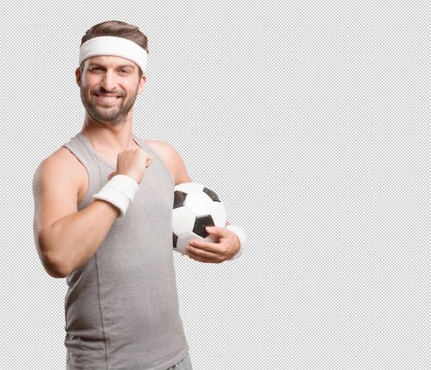 Sportowy człowiek z piłką nożną