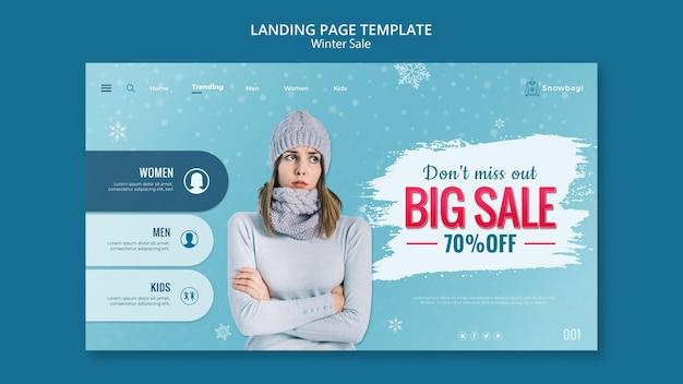 Strona docelowa dla zimowej sprzedaży z kobietą i płatkami śniegu