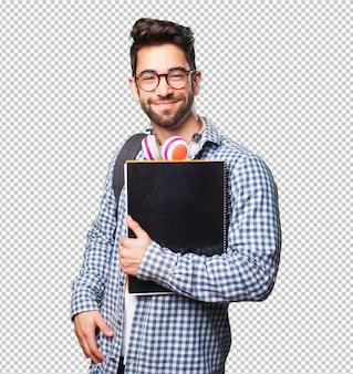 Studencki mężczyzna trzyma książkę