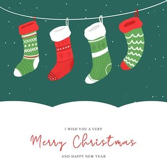 Świąteczna kartka z życzeniami z świąteczną dekoracją skarpety