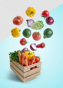 Świeże warzywa latające w drewnianym pudełku na białym tle