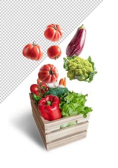 Świeże warzywa latające w makiecie drewnianej skrzyni