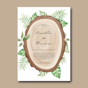 Szablon zaproszenia ślubne z kawałkiem drewna i akwarela tropikalnymi liśćmi