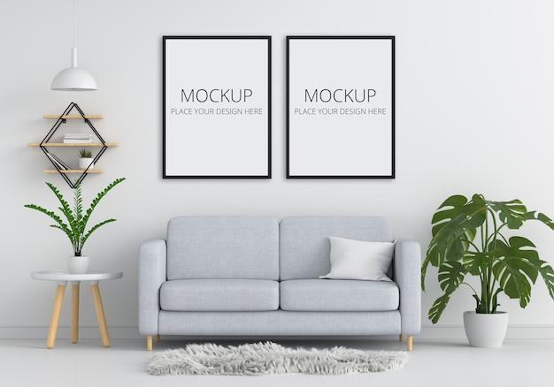 Szara sofa i stół w białym salonie z makietą ramy