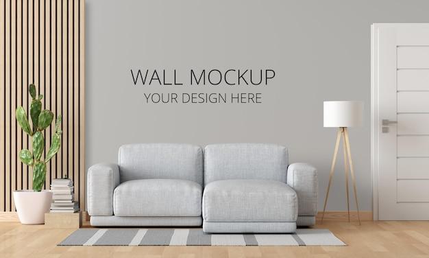 Szara sofa w białym wnętrzu salonu z makietą ścienną