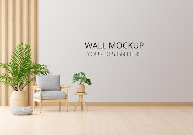 Szary fotel w białym salonie z makietą ścienną