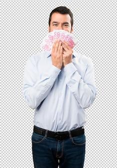 Szczęśliwy przystojny mężczyzna z brodą bierze mnóstwo pieniądze