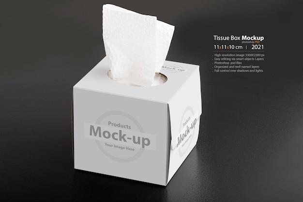 Sześcienne pudełko chusteczek na czarnym tle, edytowalna seria makiet psd z szablonem warstw obiektów inteligentnych gotowym do projektowania
