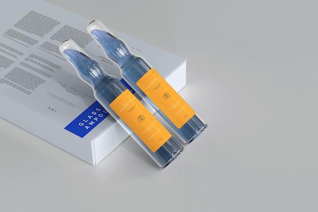 Szklana ampułka z makietą pudełka