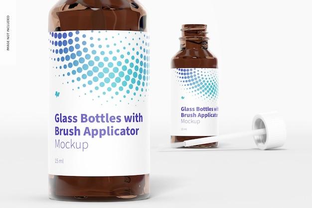 Szklane butelki z makietą aplikatora pędzla, zbliżenie
