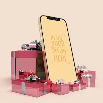 Telefon komórkowy otoczony prezentami
