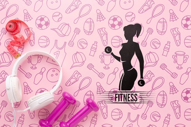 Trening fitness z ciężarkami i słuchawkami