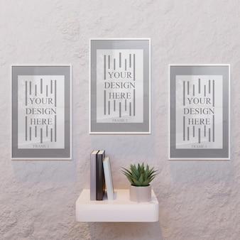 Trzy białe makiety poziomej ramy na biurku na ścianie