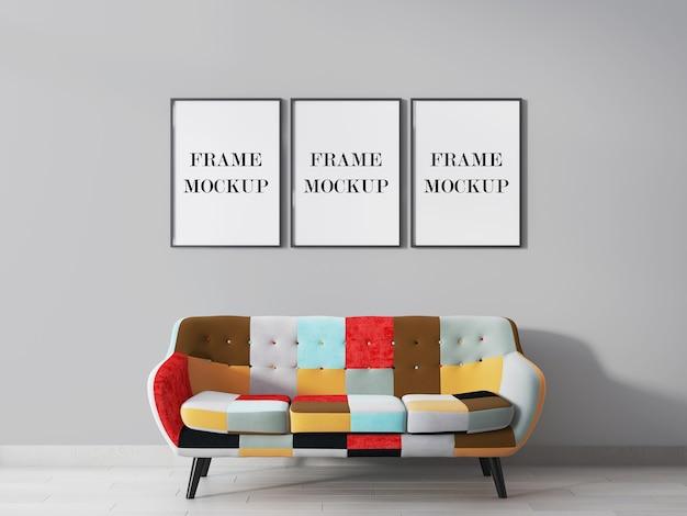 Trzy makieta ramy ścienne powyżej renderowania 3d kolorowa sofa