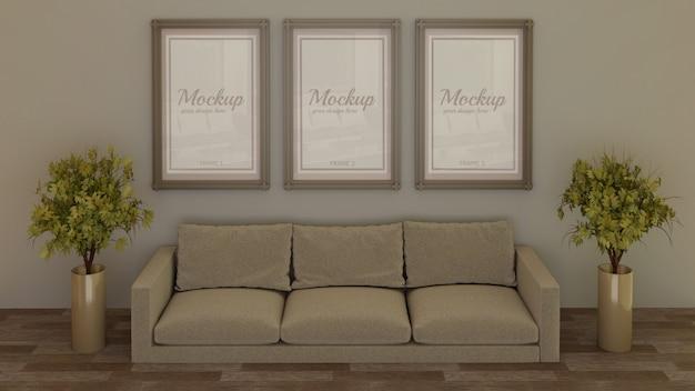 Trzy ramki makieta na ścianie za kanapą w salonie